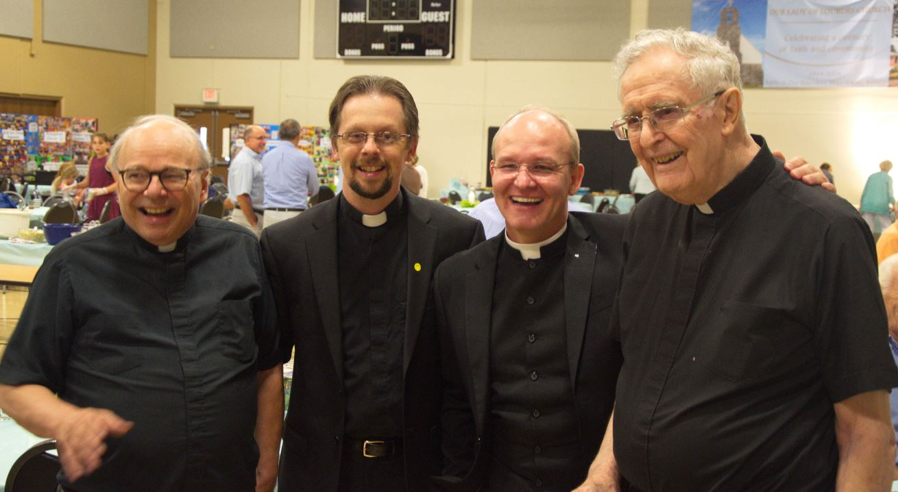 Fathers Schmalhofer, Fauser, Guzman and McGarrity